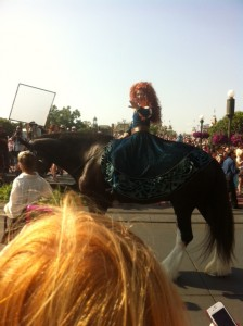 Merida riding in on Angus for her official coronation at Walt Disney World on Saturday May 11