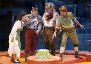 (L to R) Wendy (Justine Moral), Tootles (Matt Dewberry), Slightly (Dan Van Why), and Peter Pan (Jonathan Atkinson) find a cake in the forest in PETER PAN AND WENDY at Imagination Stage. Photo Credit: Margot Schulman